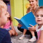 Adult Reading to Children sat on floor
