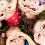 Children doing through hand glasses